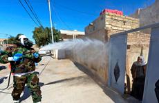 Iraq sử dụng vòi rồng chống bạo động để phun thuốc khử trùng
