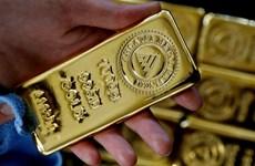 Giá vàng thế giới phiên 25/3 giảm do hoạt động mua quá mức trước đó
