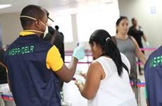 Dịch COVID-19: Haiti có ca tử vong đầu tiên, Argentina cấm việc đầu cơ