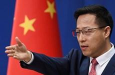 Trung Quốc bác thông tin chậm trễ chia sẻ với WHO về COVID-19