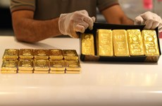 Giá vàng thế giới giảm do hoạt động chốt lời sau tuyên bố của Fed
