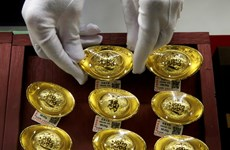 Chờ đợi chính sách của Fed, giá vàng châu Á giảm gần 1% chiều 14/6