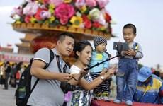 Quốc hội Trung Quốc thảo luận dự thảo sửa đổi cho phép sinh con thứ ba