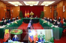 Ông Võ Văn Thưởng hội đàm trực tuyến với Thường trực Ban Bí thư Lào