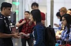 Malaysia trì hoãn quy định mới về thuế hộ chiếu với lao động ngoại