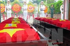 Truy điệu và an táng 16 hài cốt liệt sỹ Việt Nam hy sinh tại Lào