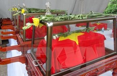 Tiếp nhận, an táng 26 hài cốt liệt sỹ Việt Nam hy sinh tại Lào