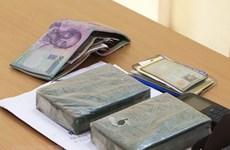 Bộ đội Biên phòng tỉnh Lào Cai bắt đối tượng vận chuyển 2 bánh heroin