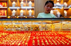 Đồng USD mạnh lên tiếp tục chi phối thị trường vàng thế giới
