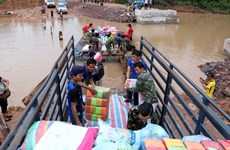 Việt Nam hỗ trợ Lào khắc phục hậu quả sự cố vỡ đập thủy điện