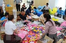 Người Việt tại Lào hỗ trợ người dân vùng ảnh hưởng vì sự cố vỡ đập