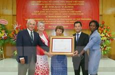 Trao Huân chương Hữu nghị cho tổ chức Đông Tây hội ngộ của Mỹ
