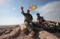 Syria: Đoàn xe chở các tay súng người Kurd rời khỏi Manbij