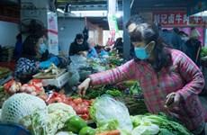 Lạm phát tháng 1 của Trung Quốc tăng nhanh nhất trong hơn 8 năm