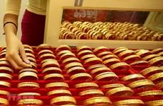 Giá vàng thế giới giảm dù có lúc vượt ngưỡng 1.700 USD mỗi ounce