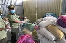 Phát hiện hàng chục tấn găng tay y tế đã qua sử dụng tại Bình Dương