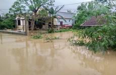 [Photo] Nhiều nơi tại miền Trung nước ngập sâu đến tận nóc nhà