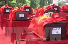 An táng 95 hài cốt liệt sỹ quân tình nguyện Việt Nam hy sinh ở Lào