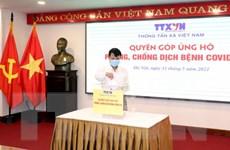 [Photo] Thông tấn xã Việt Nam ủng hộ Quỹ phòng, chống COVID-19