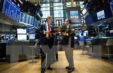 Fed duy trì lãi suất thấp, chứng khoán Mỹ đồng loạt tăng điểm