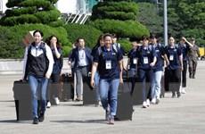 Đội thể thao chung liên Triều mặc đồng phục do Hàn Quốc sản xuất