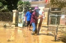 [Photo] Người dân Quảng Bình khẩn trương khắc phục hậu quả mưa lũ