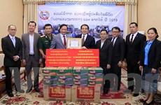 Lào tiếp nhận hỗ trợ của cộng đồng người Việt giúp dân vùng thiên tai