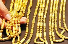 Giá vàng kỳ hạn tăng dù thị trường chứng khoán Mỹ lên điểm