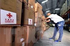 IMF và WTO cảnh báo nguy cơ từ hạn chế xuất thiết bị y tế