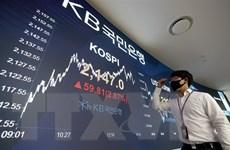 Chứng khoán châu Á đi lên sau khi phố Wall đạt mức cao kỷ lục