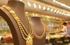 Đồng USD yếu, giá vàng châu Á đứng vững ở mức 1.800 USD