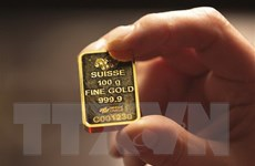 Giá vàng thế giới giảm nhẹ do giới đầu tư bán ra chốt lời