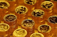 Giá vàng thế giới đi xuống, còn gần 1.856 USD một ounce