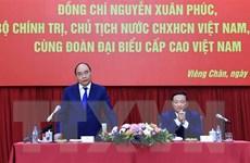 Chủ tịch nước gặp đại diện cộng đồng và doanh nghiệp Việt Nam tại Lào