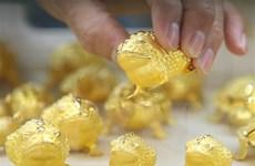Giá vàng giao dịch tại thị trường châu Á tăng sau hai ngày giảm