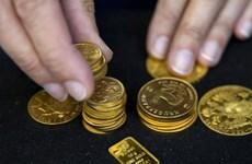 Giá vàng giao ngay tại châu Á giảm trong khi đồng USD yếu đi