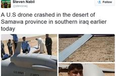 Người dân Iraq thích thú chụp ảnh bên chiếc máy bay rơi của Mỹ