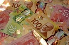 Giá dầu thế giới khiến giá đồng đôla Canada giảm mức kỷ lục