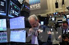 Chứng khoán Mỹ giảm điểm sau phát biểu của Fed về tăng trưởng cân bằng