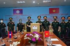 Dịch COVID-19: Lào tiếp nhận hỗ trợ y tế của Bộ Quốc phòng Việt Nam