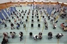 """Dịch COVID-19: Nhật Bản chuẩn bị cấp """"hộ chiếu vaccine"""""""