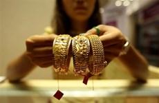 Giá vàng châu Á chiều 29/6 giảm xuống gần mức thấp của 1 tuần