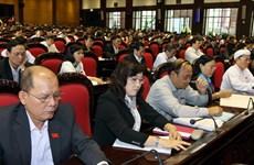 Đại biểu Quốc hội biểu quyết thông qua hai dự án Luật