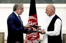 Hai ứng cử viên đối địch ở Afghanistan chia sẻ quyền lực
