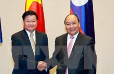 Việt Nam và Lào ký kết 4 văn kiện hợp tác quan trọng