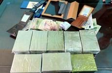 """Bắt """"nóng"""" hai đối tượng đang vận chuyển 30 bánh heroin ở Sơn La"""