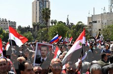Người dân Syria xuống đường ủng hộ tổng thống Bashar al-Assad