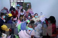 Cộng đồng người Việt chung tay giúp người dân Lào khắc phục sự cố