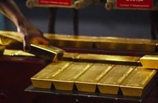 Giá vàng thế giới rơi xuống mức thấp nhất trong một năm