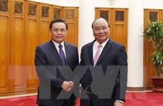 Thủ tướng: Không để các thế lực thù địch chia rẽ quan hệ Việt-Lào